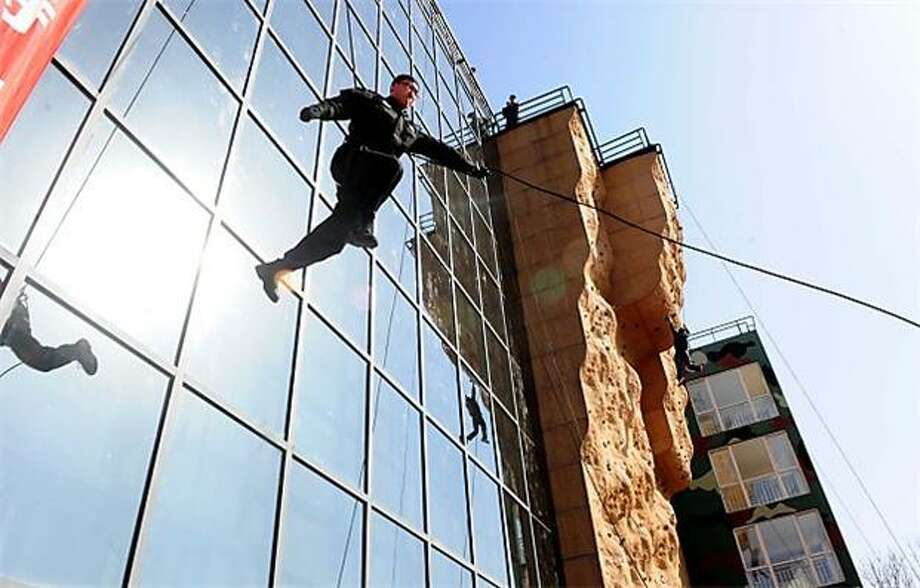 Crime is up in China and so are the police:With crime rates rising steadily in China in recent years, police in Beijing have been honing their rock-climbing skills. Photo: Str, AFP / Getty Images / AFP / Getty Images