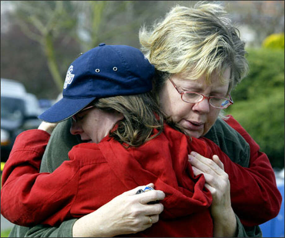 (Editor's Note: This caption has been altered. The original version of this caption misidentified the two women.) Becky Martin (right), the mother of Jeremy Martin, 26, one of the victims in the second largest mass murder in Seattle's history, gets a hug from Sara Linde, her son's neighbor, on Sunday. Photo: Jim Bryant, Seattle Post-Intelligencer / SEATTLE POST-INTELLIGENCERF