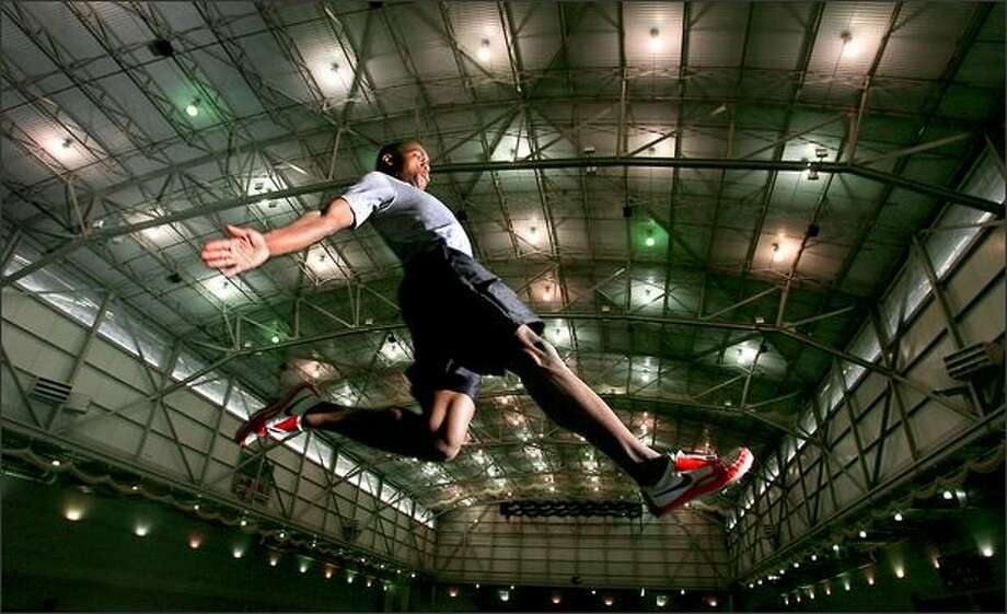 University of Washington's Norris Frederick, a record setting long jumper and one of the best in the country, works out at the Dempsey Indoor Center at the University of Washington in Seattle. Photo: Scott Eklund, Seattle Post-Intelligencer / Seattle Post-Intelligencer
