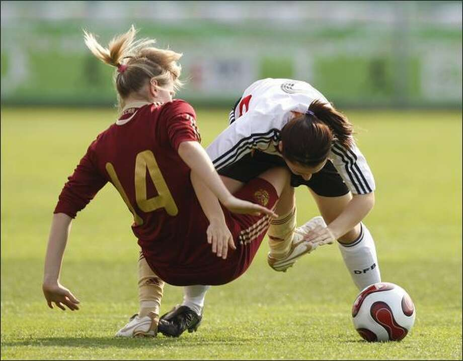 Kristina Mashkova, left, of Russia and Nicole Rolser of Germany fight for the ball during the U17 Women international friendly match between Germany and Russia in Sopron, Hungary. Photo: Getty Images / Getty Images
