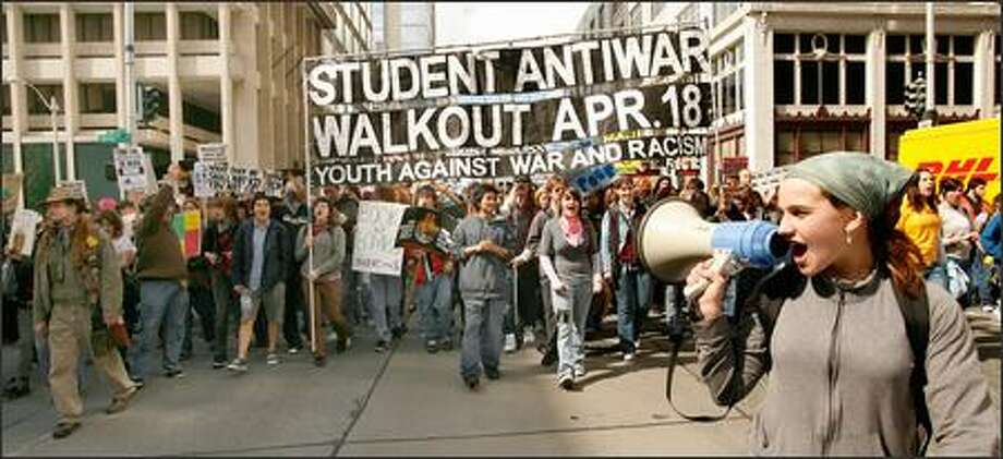 "Renton High School freshman Alissa Reynolds, 15, leads student protesters in a chant of ""Seattle! While you're shopping, bombs are dropping"" as they march down Second Avenue to the Federal Building Wednesday afternoon to protest the war in Iraq. Photo: Grant M. Haller, Seattle Post-Intelligencer / Seattle Post-Intelligencer"