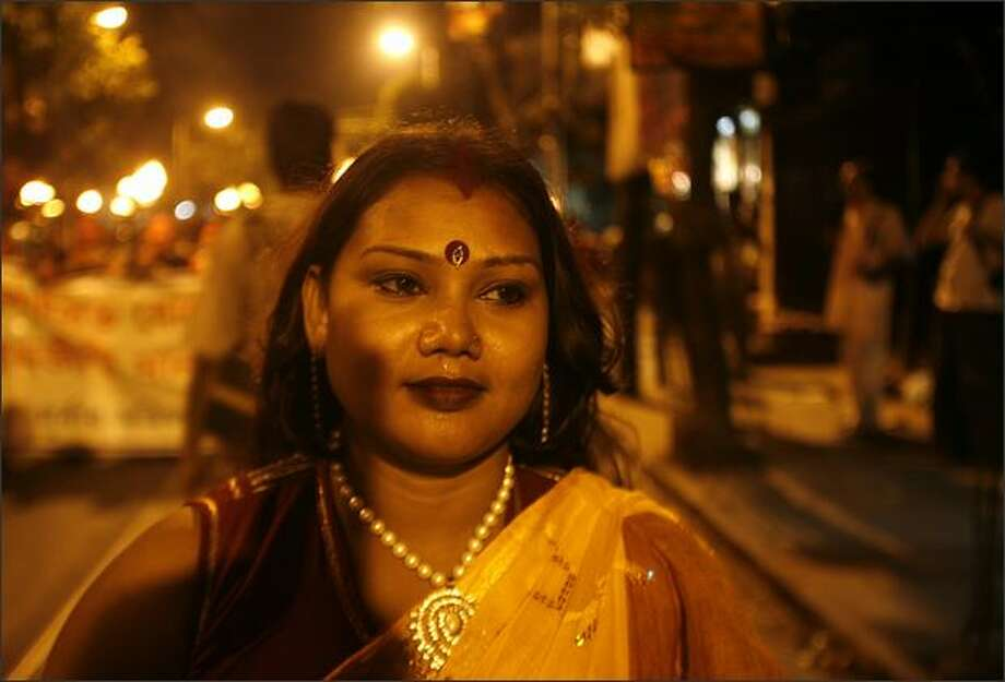 A sex worker walks on a street during a torch-lit procession on the eve of May Day in the eastern Indian city of Kolkata. Nearly 2,000 prostitutes on Thursday held a rally to demand rights and recognition of their profession. Photo: Reuters / Reuters