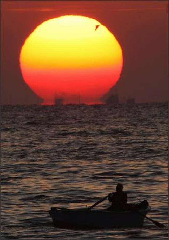 A fisherman fishes during sunset in the Mediterranean city of Alexandria, 137 miles north of Cairo. Photo: Reuters / Reuters