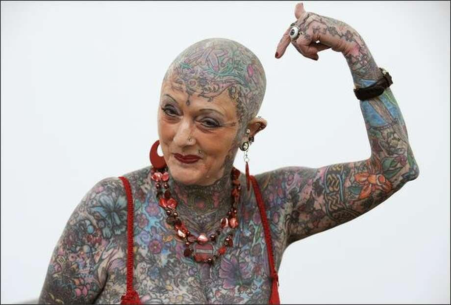 Septuagenarian Isobel Varley poses during 'II Expotatoo' tattoo fair in Gijon, northern Spain. Varley is the most senior tattooed woman in the world according to the Guinness World Records. REUTERS/Eloy Alonso Photo: Reuters / Reuters