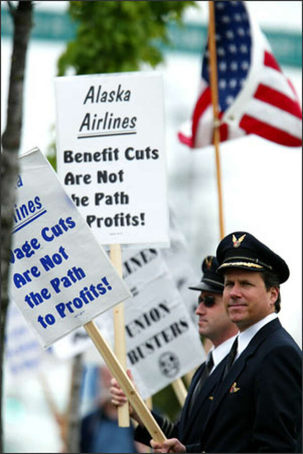 Alaska Airlines pilots Peter Barbin, left, and Glenn Vyskocic joined others picketing outside the annual shareholders meeting at the Museum of Flight. Employees are upset about layoffs and reduced pay. Photo: Paul Joseph Brown, Seattle Post-Intelligencer / SEATTLE POST-INTELLIGENCER