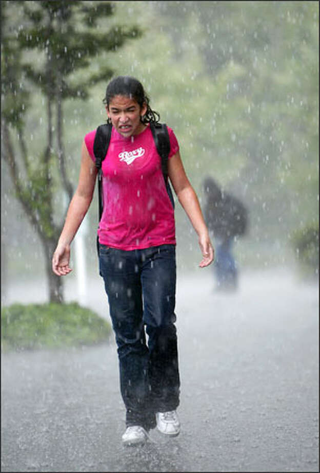 Sarah Taylor, 13, was caught off guard by a storm as she walked home from school in Federal Way. Photo: Scott Eklund, Seattle Post-Intelligencer / Seattle Post-Intelligencer