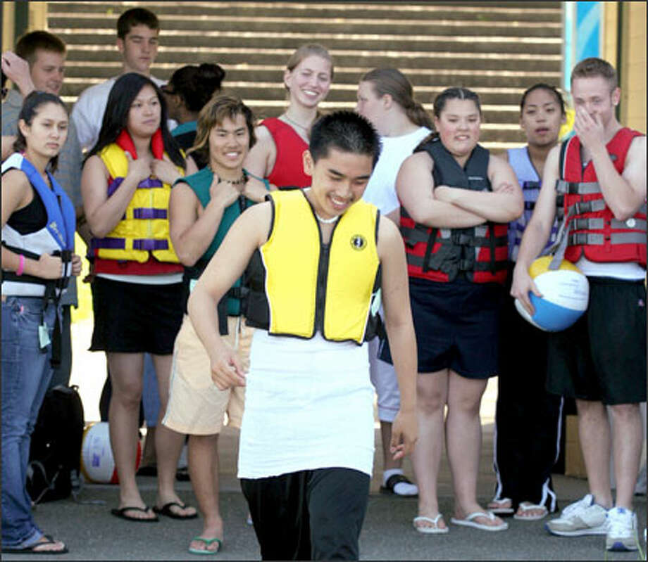 David Ly takes his turn on the catwalk -– er, pier –- to model a life vest as part of a fashion show at Mount Baker Beach Park. Students from several high schools participated in the event, which was sponsored by Children's Hospital and Public Health -- Seattle & King County, to highlight the fact that teens age 15-17 have the highest rate of drowning deaths in the state. Photo: Meryl Schenker, Seattle Post-Intelligencer / Seattle Post-Intelligencer