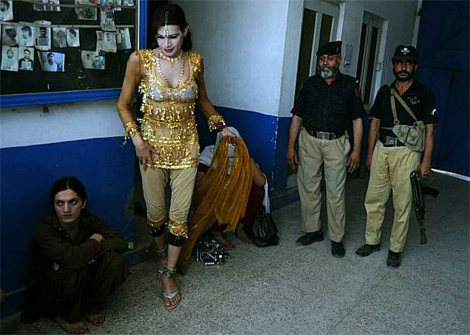 Eunuch 'wife':Police in Peshawar, Pakistan, have arrested a man for marrying a eunuch (seated) who goes by the names Kashif and Rani. Malik Iqbal faces up to 10 years in prison if convicted. Under Pakistani statutes, it's a crime for a man to marry a eunuch or another man. Photo: A Majeed, AFP/Getty Images / AFP/Getty Images