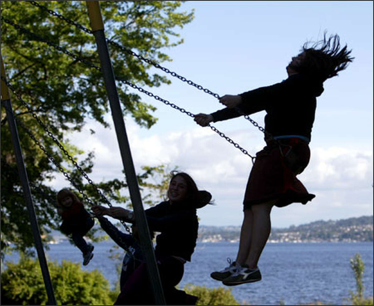 Alyssa White (right), 20, of Seattle doesn't let her age stand in the way of a good swing at Seward Park in Seattle.