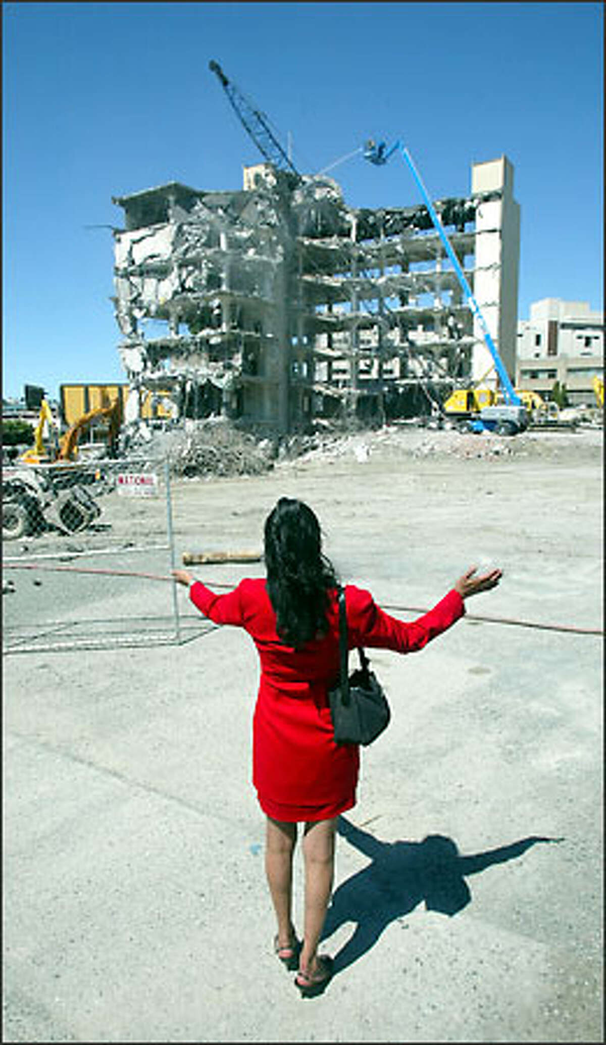 Margaret Johnson cheers on the demolition of the former Quinton Instruments Co. building in Seattle.