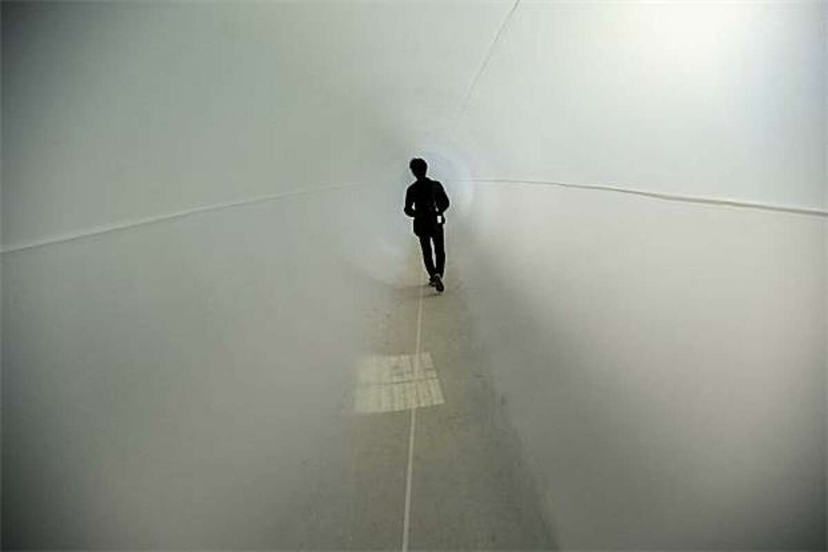 Taking the tube: A visitor walks through a plastic tunnel at the opening of Basel, Switzerland's Art 41 fair.