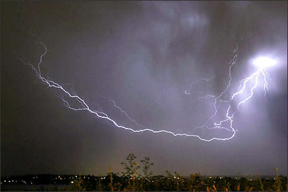 Lightning forks through the Eastside sky late Thursday night as spectacular storms moved through the region, sparking a light show that lasted past midnight. Photo: James Johnson, Seattle Post-Intelligencer / Seattle Post-Intelligencer