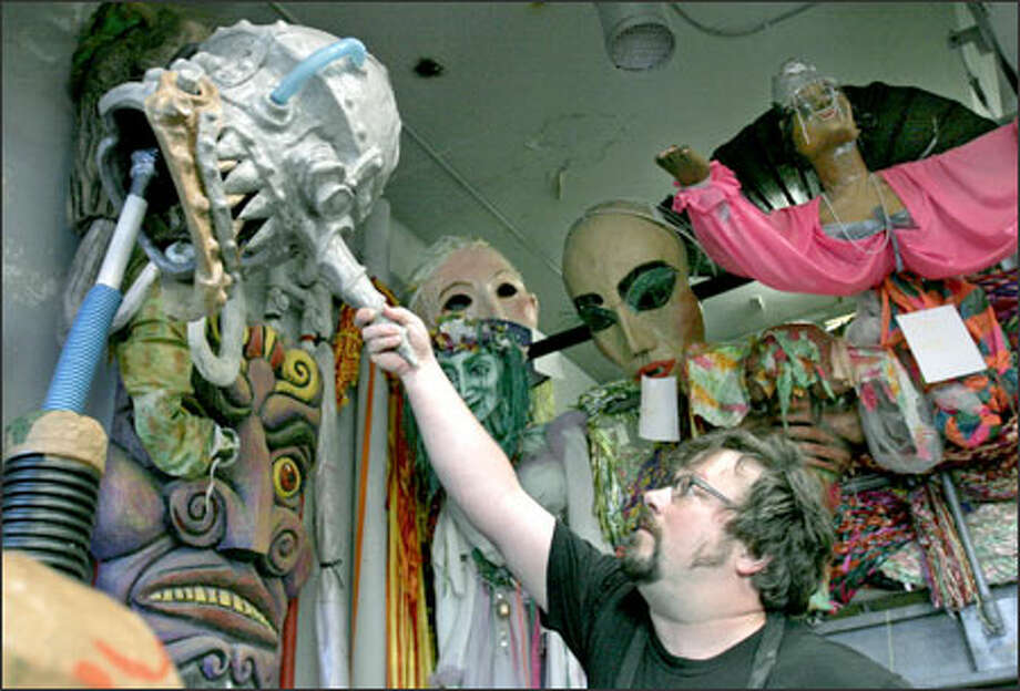 Brian Kooser, a Seattle puppet designer, puts the head on Mark II, a giant puppet he created for the Fremont Arts Council's Solstice Parade. The event is one of the highlights of the 34th Fremont Fair. Photo: Meryl Schenker, Seattle Post-Intelligencer / Seattle Post-Intelligencer