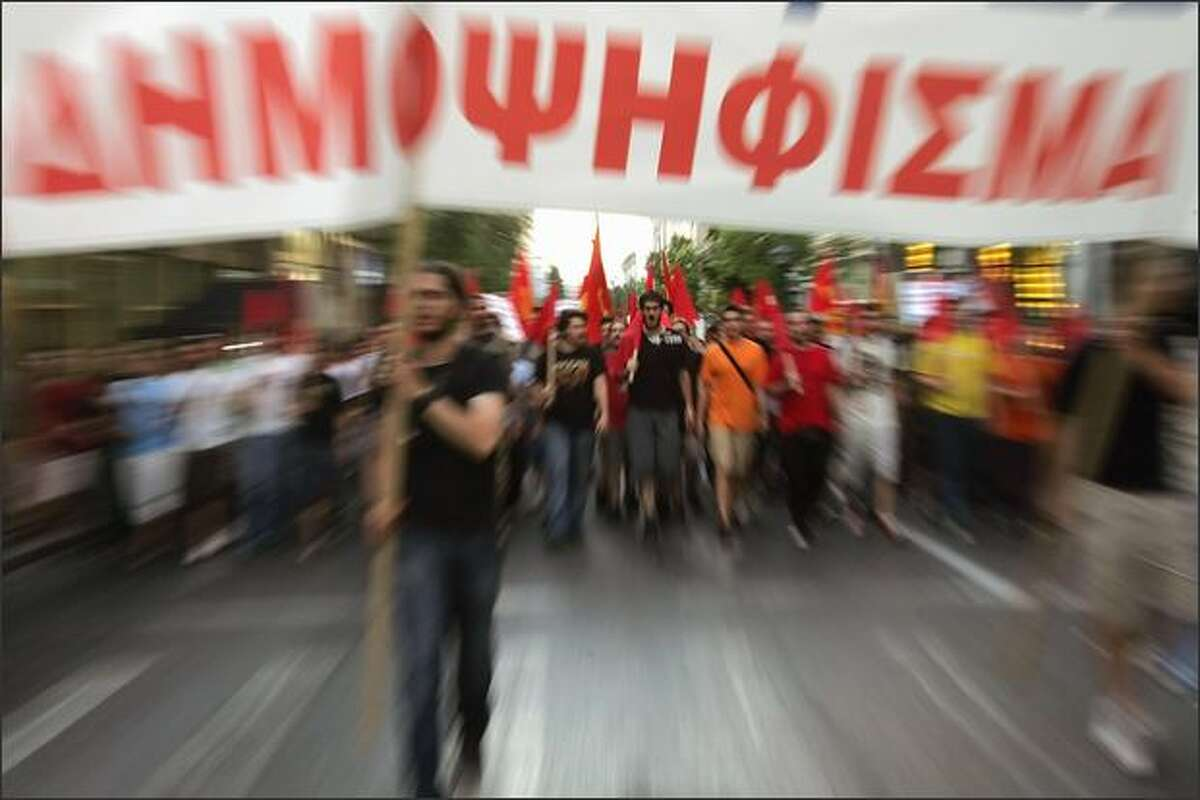 Supporters of communist party march in Athens carrying banner reading 'referendum' (now) on Tuesday. The Irish referendum vote last week against the Lisbon Treaty has pitched the whole 27-nation EU into deep turmoil because the document, which aims to make EU decision-making easier, has to be approved by all member states.