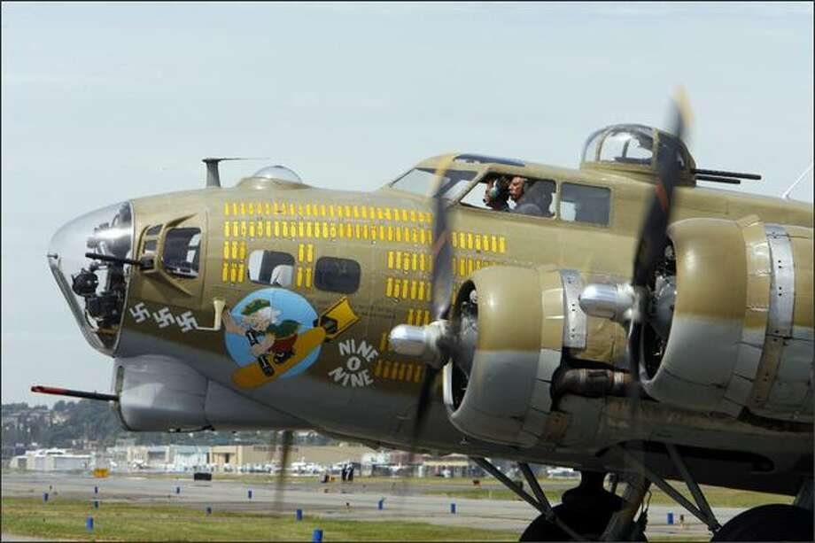 "Pilots Mac McCauley and Jim Harley taxi the Boeing B-17 Flying Fortress ""Nine O Nine"" WWII Heavy Bomber that landed as part of the Wings of Freedom Tour at The Museum of Flight in Seattle. Photo: Gilbert W. Arias, Seattle Post-Intelligencer / Seattle Post-Intelligencer"