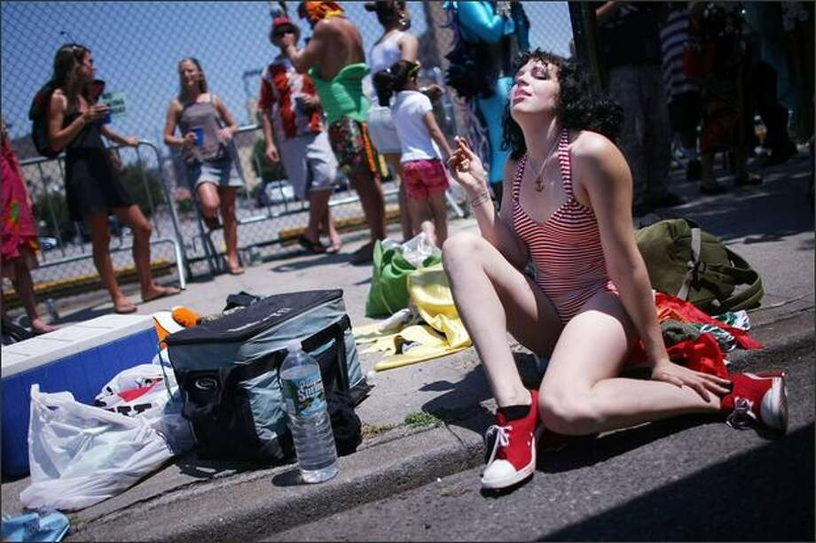 A reveler smokes at the annual Coney Island Mermaid Parade in the Brooklyn borough of New York City. One mermaid will launch a hunger strike following the parade to protest proposed development plans that critics say will ruin the amusement mecca's kitschy charm. Photo: Getty Images / Getty Images