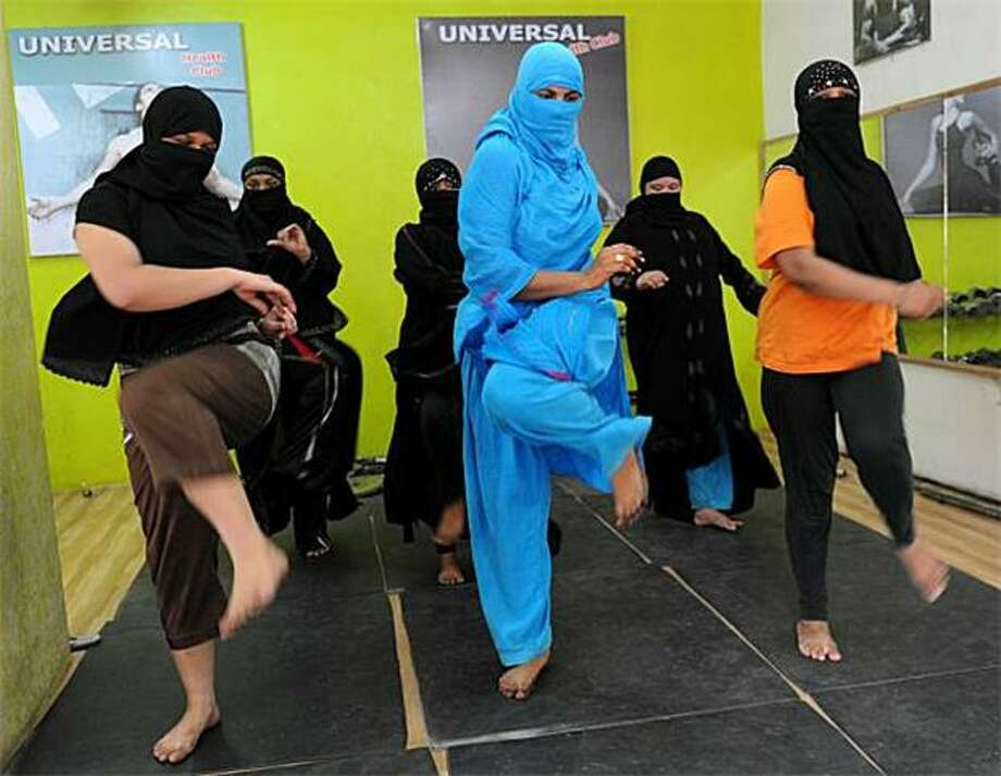 Bare feet OK, but no bare faces:Toning class is beginning at Universal Gymnasium in Ahmedabad, India. Did you remember your sweat burqa? Photo: Sam Panthaky, AFP / Getty Images / AFP / Getty Images