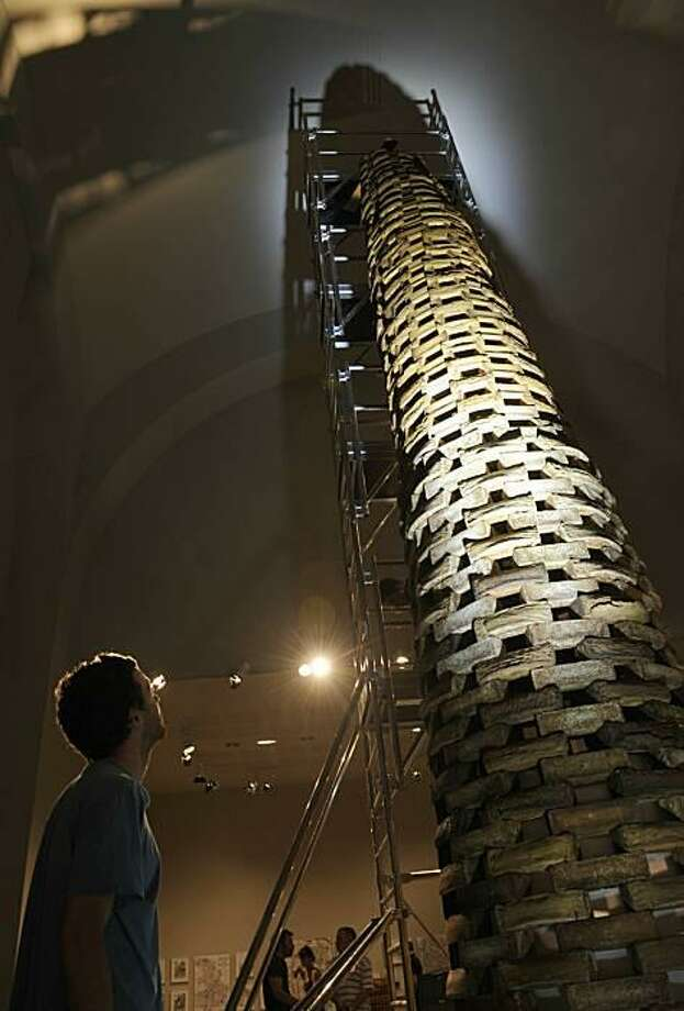 "A different kind of Tour de France: A collaboration between French architect Jean Bocabeille and chef Gilles Stassart, ""La Tour Sans Faim"" (The Tower Without Hunger) rises some 25 feet in the Cite de l'Architecture museum in Paris. Despite being made of almonds and sponge cake, it is not edible. Photo: Boris Horvat, AFP / Getty Images / AFP / Getty Images"