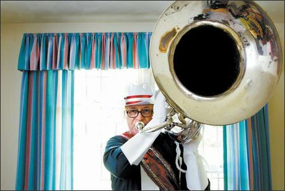 David Endicott will play the contrabass bugle when he performs next month in Wisconsin at a reunion of the Madison Scouts, an elite drum and bugle corps. Photo: Karen Ducey, Seattle Post-Intelligencer / Seattle Post-Intelligencer
