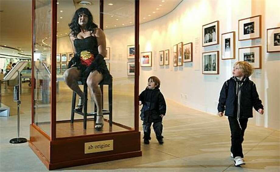 "OK, boys, let's go see the didgeridoos now: Constantina Bush, an alter-ego of male Aboriginal performance artist Kamahi King, poses in a display case at the new Aboriginal exhibition ""Bold. Black. Brilliant"" at the Melbourne Museum. The installation ""challenges audiences to reconsider their perceptions of Indigenous Australia as an anthropological curiosity."" Photo: William West, AFP / Getty Images / AFP / Getty Images"