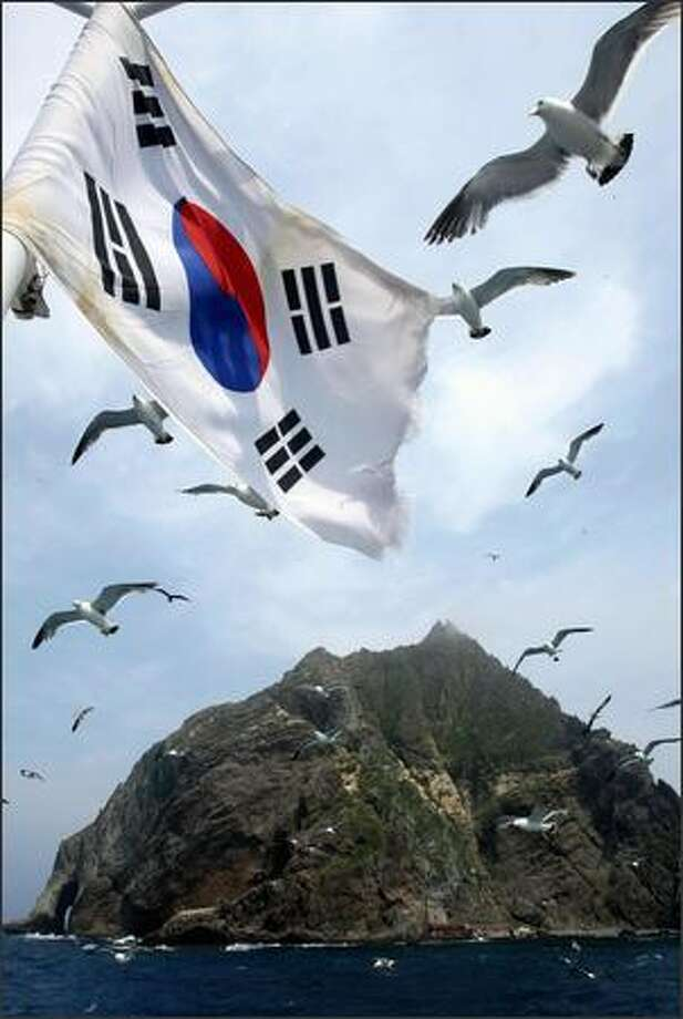 A South Korean national flag flutters aboard a ship during a tour in the Korean-controlled islands in the Sea of Japan (East Sea) -- known as Takeshima in Japan and Dokdo in South Korea.. An angry South Korea ruled out any diplomatic compromise with Japan in a worsening row over Tokyo's claim to a group of disputed islands controlled by Seoul. Photo: Getty Images / Getty Images