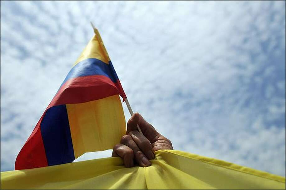 A Colombian citizen holds a Colombian flag will taking part in a rally in Panama city, held as part of a day of rallies in Europe and Latin America seeking the release of captives still held by FARC rebels in the Colombian jungle, on Sunday. The even coincided with independence day in Colombia. Photo: Getty Images / Getty Images