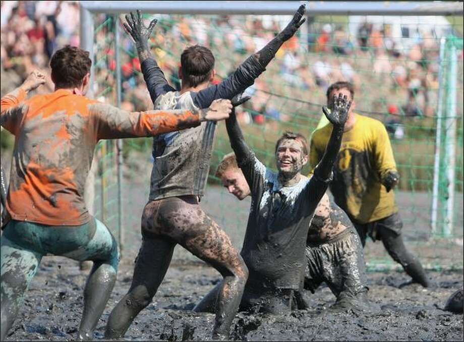 Participants play football during the Mudflat Olympic Games on Sunday in Brunsbuettel, Germany. Photo: Getty Images / Getty Images
