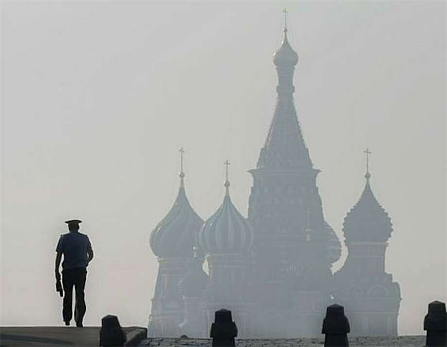 Hammer and sizzle:Smog hangs over St. Basil's Cathedral in Red Square as Moscow continued to bake in record-breaking heat. Photo: Andrey Smirnov, AFP / Getty Images / AFP / Getty Images
