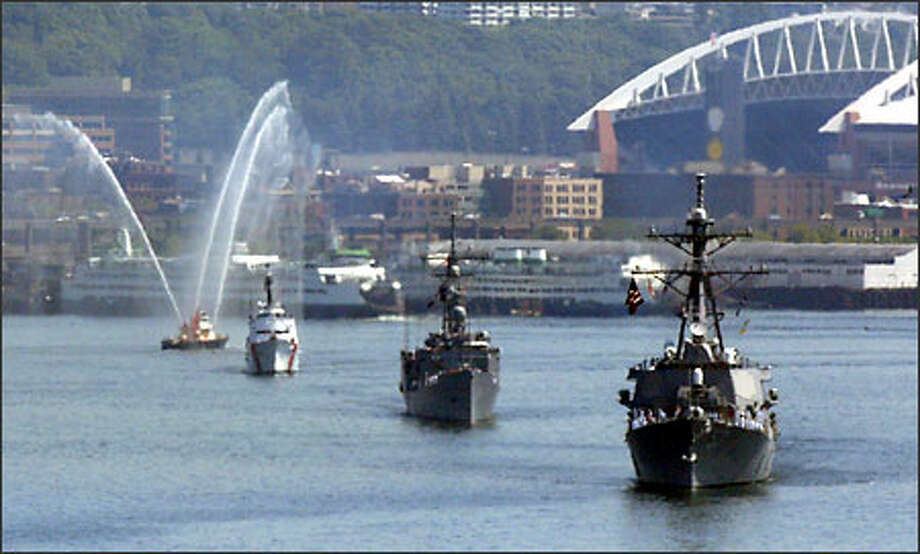 Navy ships make their way through Elliott Bay toward Pier 91 in Seattle. The ships are in town for Seafair. Photo: David Bitton, Seattle Post-Intelligencer / Seattle Post-Intelligencer