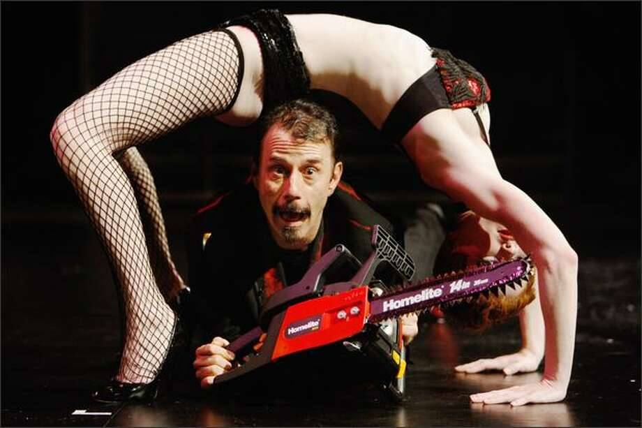 Jim Rose performs with other circus members on stage at the Udderbelly Theatre during the Edinburgh Festival Fringe on Friday in Scotland. The Jim Rose Circus is a modern-day alternative version of a circus, it was founded in Seattle in the early 1990's and has been a regular at the festival. Photo: Getty Images / Getty Images