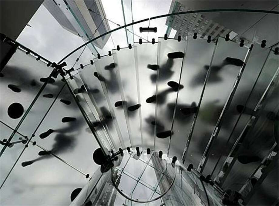 Apple download: Customers descend the spiral staircase into Apple's Fifth Avenue Store in New York. Photo: Timothy A. Clary, AFP / Getty Images / AFP / Getty Images