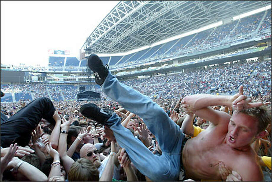 Fans rock and surf to the band Linkin Park at Seahawks Stadium, where the Summer Sanitarium Tour featuring Metallica hit Seattle. Photo: Scott Eklund, Seattle Post-Intelligencer / Seattle Post-Intelligencer