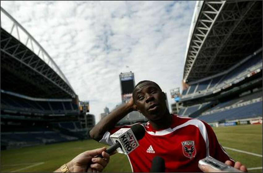 D.C. United and MLS star Freddy Adu talks with reporters after practice Tuesday at Qwest Field in Seattle. Adu and the D.C. United team will take on Real Madrid and international superstar David Beckham Wednesday night before an expected crowd of more than 60,000.
