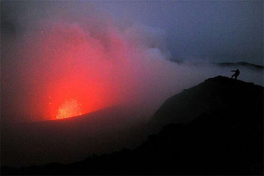You're getting warmer: Mt. Yasur - the most active of Vanuatu's nine volcanoes - is roaring to life on Tanna Island following a 7.6-magnitude earthquake that rocked the Pacific island nation. So what is this guy doing within spitting distance of bubbling lava? Photo: Torsten Blackwood, AFP / Getty Images / AFP / Getty Images