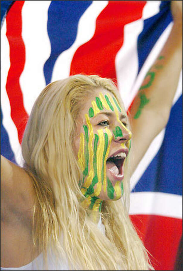 Seattle Storm star, WNBA Most Valuable Player and Australian Olympic basketball women's team member Lauren Jackson supports the Australian men's team  in Athens during its 89-79 loss to the United States. Photo: William Luther, San Antonio Express News / San Antonio Express News