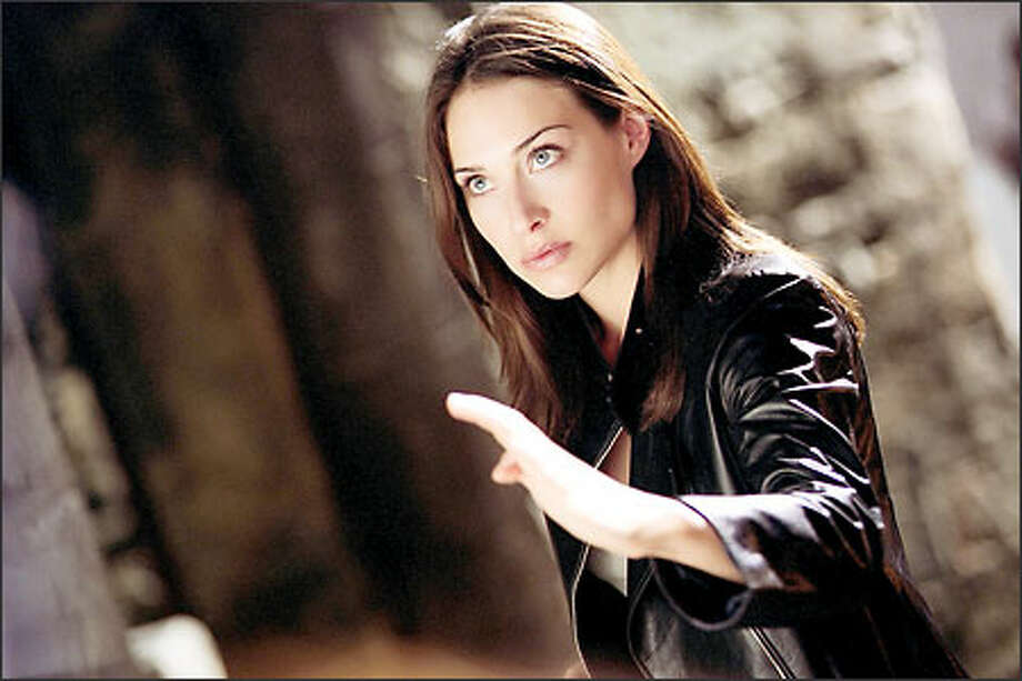 "Odd casting or desperate career move? Actress Claire Forlani, normally associated with more serious roles, portrays Interpol agent Nicole James in ""The Medallion,"" starring martial arts kingpin Jackie Chan. The film opens in theaters Friday. (Golden Port Productions, Ltd.)"