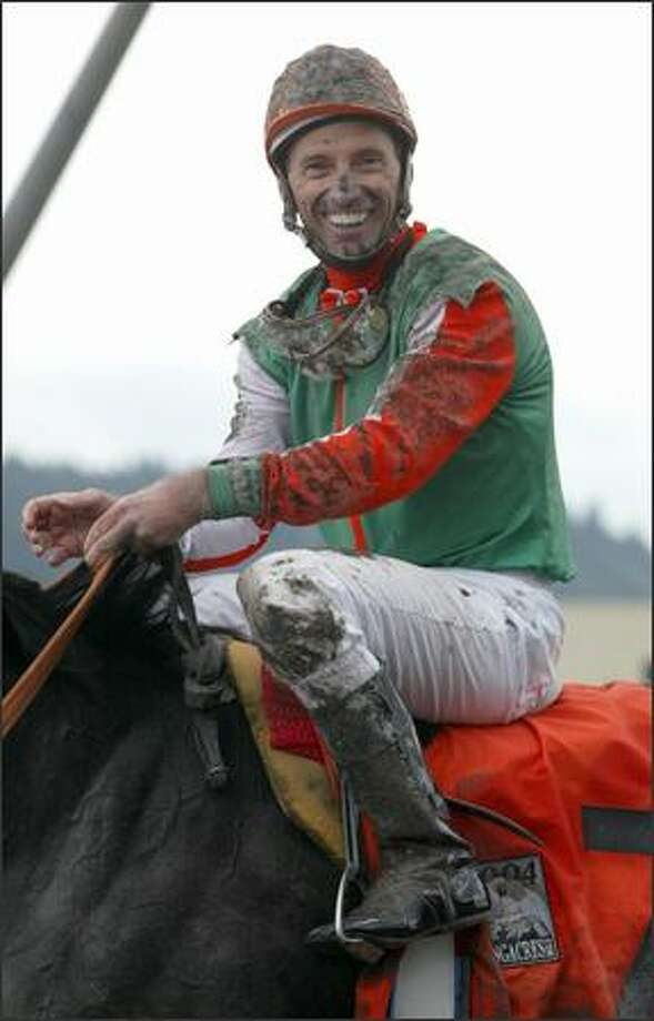 "Jockey Russell Baze beams from aboard Adreamisborn after winning his second consecutive Longacres Mile and third overall. ""This is the big race in this area and it was home to me for a lot of years so this is almost as much fun as anything I've ever done,"" the Hall of Fame rider said. Photo: Scott Eklund, Seattle Post-Intelligencer / Seattle Post-Intelligencer"