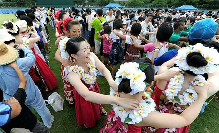 You can't always get who you knead: A conga line of hundreds attempts to break the Guinness world record for longest massage chain in Yachiyo, Japan. Unfortunately, the bid was unable to muster more than 1,223 participants, the current record. Photo: Toru Yamanaka, AFP / Getty Images / AFP / Getty Images