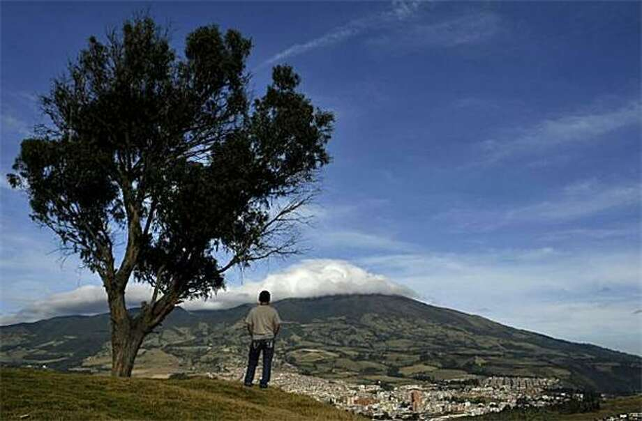 Smoking:A man looks at the Galeras volcano in Pasto, Colombia, after its most recent eruption. Some 8,000 people living around the volcano have been evacuated. No one has been injured. Photo: Luis Robayo, AFP / Getty Images / AFP / Getty Images