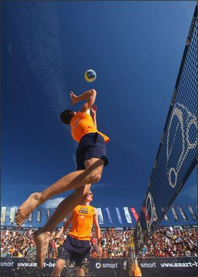 Markus Bockermann and Tom Gotz in action during the third and fourth place match during the men's final of the German Smart beach volleyball championships on Sunday near Luebeck, Germany. Photo: Getty Images / Getty Images