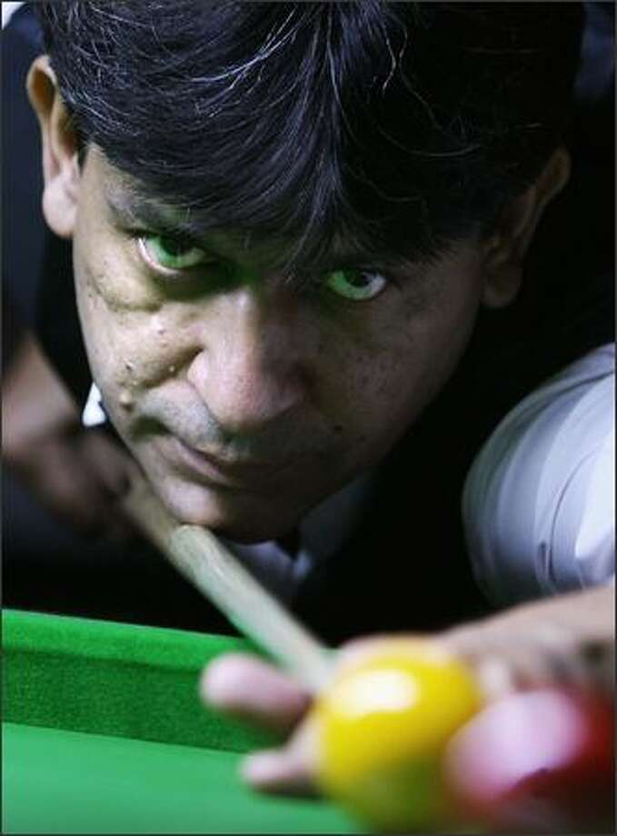 Indian Billiards player Geet Sethi plays a shot during practice session in Bangalore on Monday. The world's leading Billiards players gathered in Bangalore to participate in the International Billiards and Snooker Fedaration (IBSF) World Championship. Photo: Getty Images / Getty Images