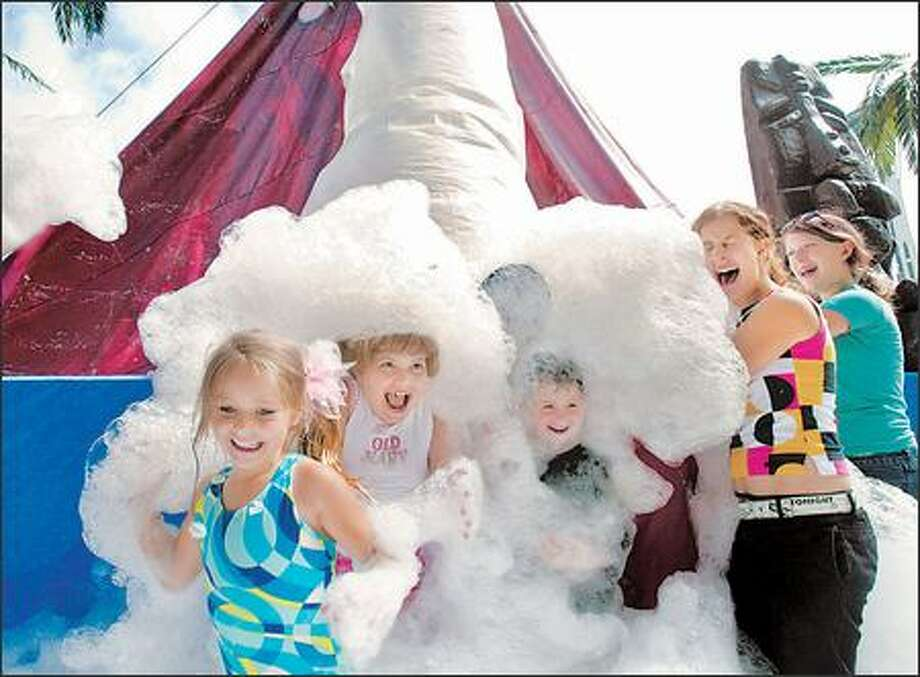 "The 35th Bumbershoot began with an ""eruption"" of foam from a pink volcano erected near the International Fountain. Eruptions will continue throughout the weekend. Photo: Paul Joseph Brown, Seattle Post-Intelligencer / Seattle Post-Intelligencer"