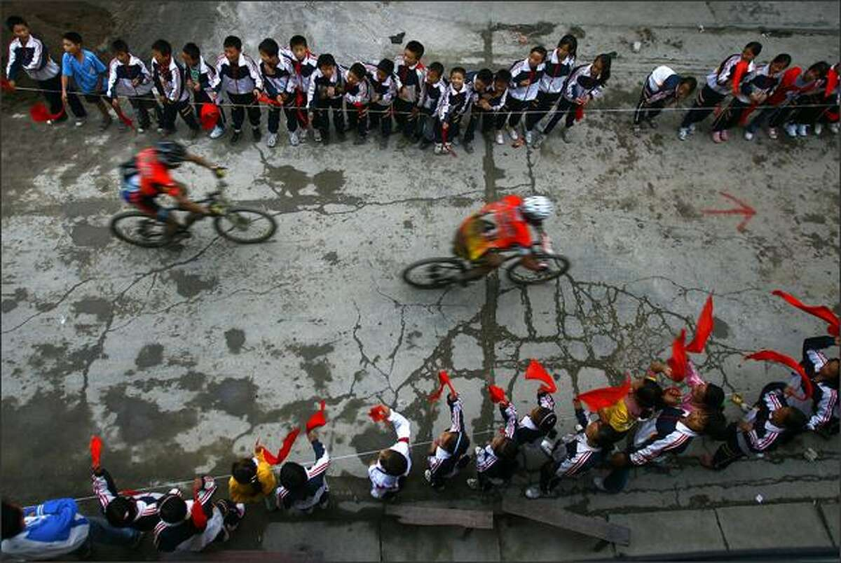 Contestants compete during the bicycle riding session of the Wulong Mountain Quest on on Tuesday in Wulong County of Chongqing Municipality, China. The event that started Saturday lasts four days and brought 14 teams from 13 countries and regions. Participants include the United States, New Zealand, France, and Sweden.