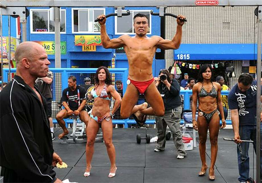 Just one more pull-up, Mr. Sulu:Bodybuilders warm up for the Muscle Beach Championship bodybuilding and bikini competition at Venice Beach, where Gov. Arnold Schwarzenegger once pumped iron. Photo: Mark Ralston, AFP / Getty Images / AFP / Getty Images