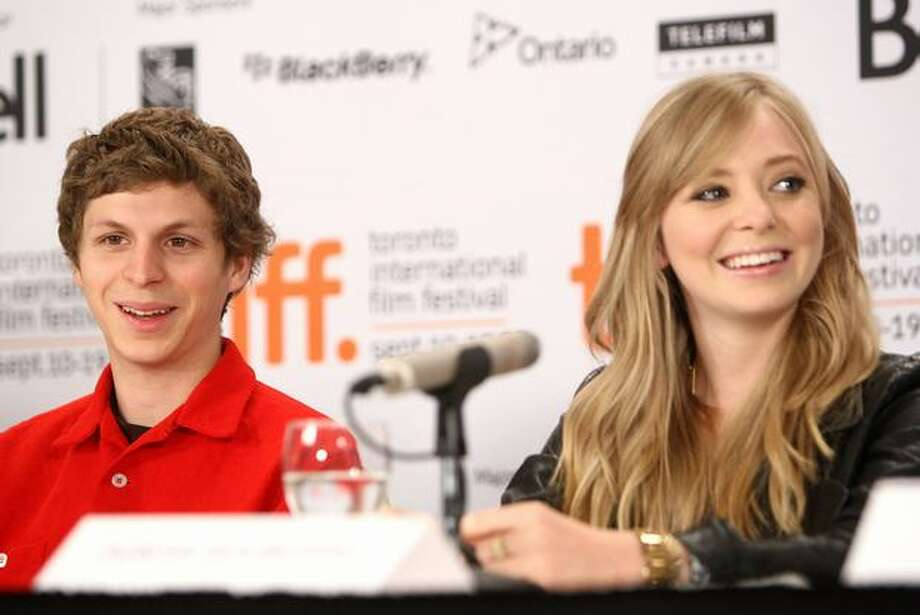 "(L-R) Actors Michael Cera and Portia Doubleday speak onstage at the ""Youth In Revolt"" press conference held at the Four Seasons Hotel on Wednesday in Toronto, Canada. Photo: Getty Images / Getty Images"