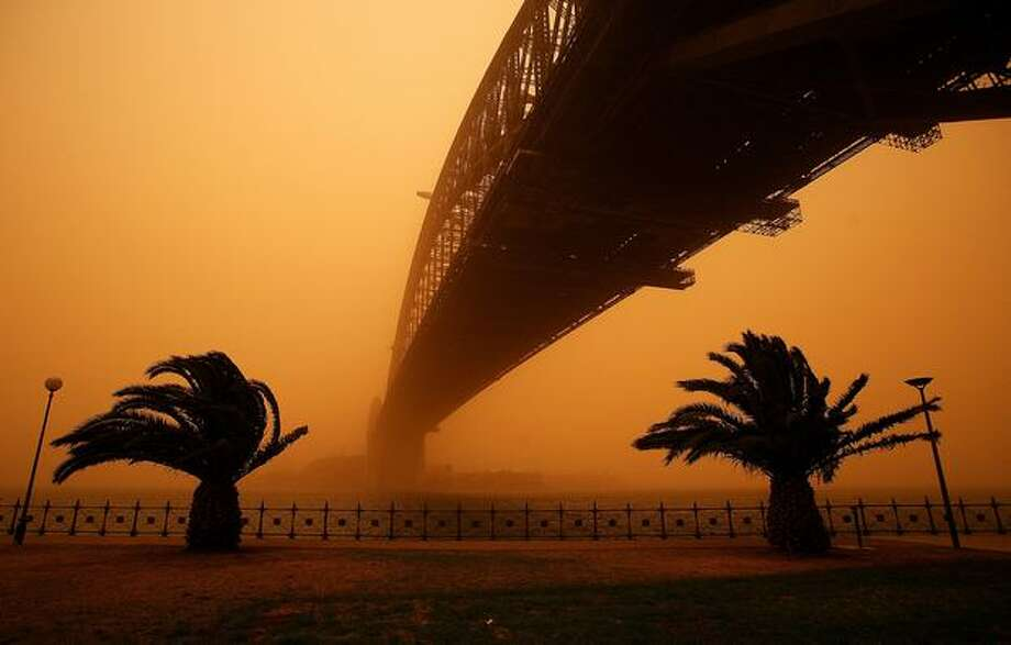 The Sydney Harbour Bridge is seen on Wednesday in Sydney, Australia. Severe wind storms in the west of New South Wales have blown a dust cloud that has engulfed Sydney and surrounding areas. Photo: Getty Images / Getty Images