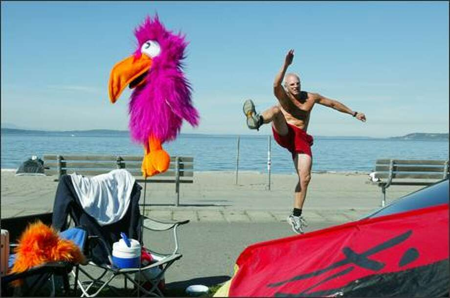 "With boundless energy and despite the lack of interest of a certain purple bird, Jason Trevor of Newcastle dances at Seattle's Alki Beach on Monday. Trevor uses dance in his exercise routine. ""I dance because it's my passion. I love the way the music makes me feel."" Photo: Dan DeLong, Seattle Post-Intelligencer / Seattle Post-Intelligencer"