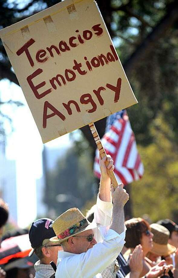 Join the movement! The only thing missing is 'u'!A man holds a spelling-challenged sign at a tea party rally in Beverly Hills. Photo: Robyn Beck, AFP / Getty Images / AFP / Getty Images