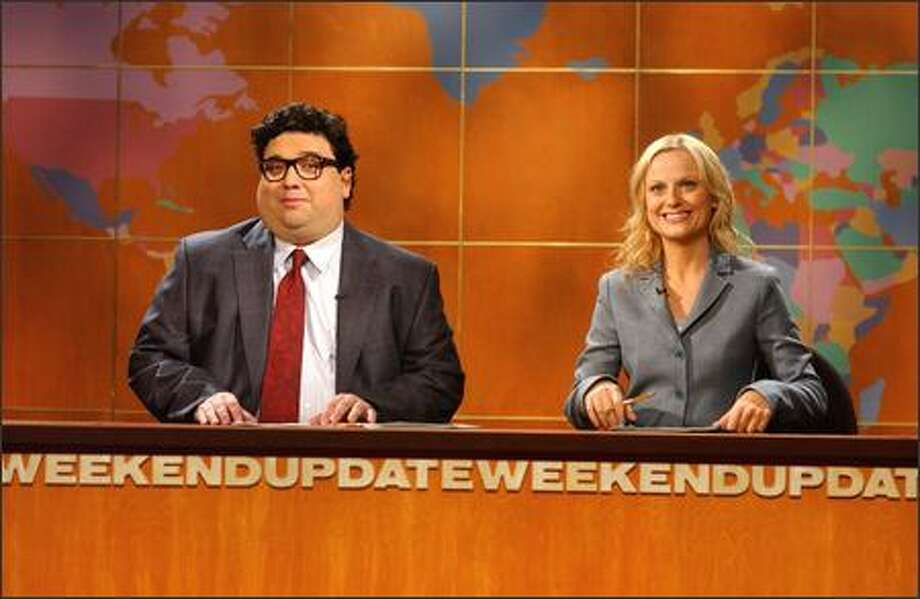 """Saturday Night Live"" cast member Horatio Sanz, left, joins Amy Poehler behind the ""Weekend Update"" anchor desk as the new season kicks off. Sanz is filling in for Tina Fey, who is on maternity leave. Photo: NBC / NBC"
