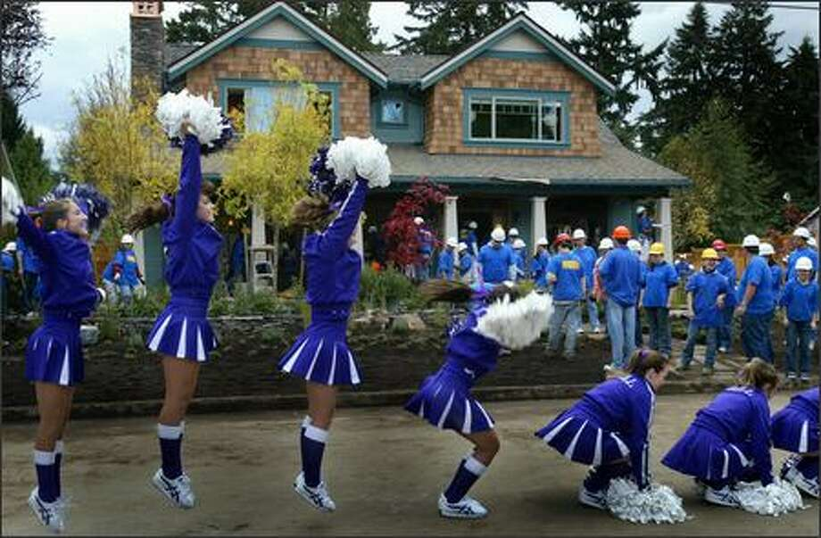 "Students from Lake Washington High School's drill team cheer on construction workers at the project site for ""Extreme Makeover: Home Edition"" in the Highlands Park neighborhood of Kirkland. Molly Chapin,  one of the children who will live in the home at 10203 116th Ave. N.E., is on the drill squad.  The planned Wednesday unveiling of the Chapins' rebuilt home was postponed until Thursday morning because of contruction delays caused by this week's stormy weather. Photo: Joshua Trujillo, Seattlepi.com / seattlepi.com"